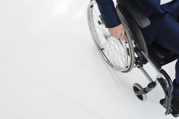 portrait-smiling-colleagues-standing-man-sitting-wheelchair_23-2148127425